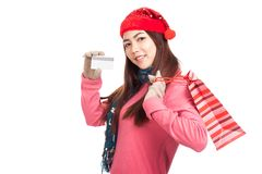 Asian girl with red christmas hat ,credit card and shopping bag Stock Photos