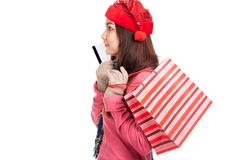 Asian girl with red christmas hat ,credit card and shopping bag Stock Image