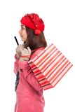 Asian girl with red christmas hat ,credit card and shopping bag Stock Images