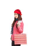 Asian girl with red christmas hat ,credit card and shopping bag Royalty Free Stock Photos
