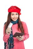 Asian girl with red christmas hat,credit card and tablet PC Stock Image