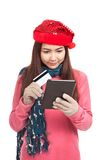 Asian girl with red christmas hat,credit card and tablet PC Stock Photos