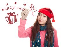 Asian girl with red christmas hat draw merry x' mas Stock Photography