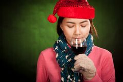 Asian girl with red christmas hat drink red wine Royalty Free Stock Photography