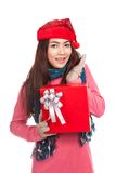 Asian girl with red christmas hat excited with gift box Royalty Free Stock Image