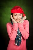 Asian girl with red christmas hat excited and smile Royalty Free Stock Images