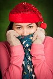 Asian girl with red christmas hat feel cold Royalty Free Stock Images