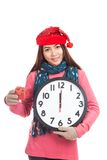 Asian girl with red christmas hat gift box and clock Stock Photography
