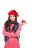Asian girl with red christmas hat with gift box on her palm hand Royalty Free Stock Images