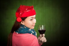 Asian girl with red christmas hat with glass of wine Royalty Free Stock Image