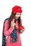 Asian girl with red christmas hat look inside a gift box Stock Photos
