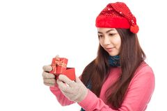 Asian girl with red christmas hat look inside a gift box Stock Image