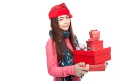 Asian girl with red christmas hat with many gift boxes Stock Image