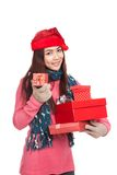 Asian girl with red christmas hat with many gift boxes Royalty Free Stock Photo