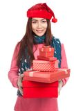 Asian girl with red christmas hat with many gift boxes Stock Photos