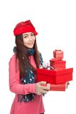 Asian girl with red christmas hat with many gift boxes Royalty Free Stock Photos