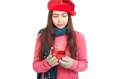Asian girl with red christmas hat open gift box Royalty Free Stock Image