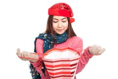 Asian girl with red christmas hat open and look inside shopping Stock Photos