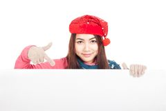 Asian girl with red christmas hat point down to blank sign Royalty Free Stock Photo