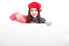 Asian girl with red christmas hat point down to blank sign Stock Photos