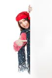 Asian girl with red christmas hat point to blank board Royalty Free Stock Photo