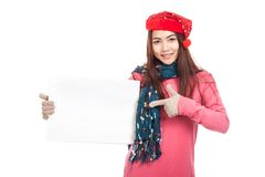 Asian girl with red christmas hat point to  blank sign Stock Photography