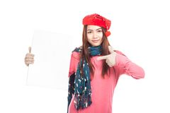 Asian girl with red christmas hat point to vertical blank sign Stock Images