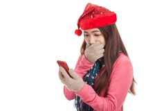 Asian girl with red christmas hat shock with mobile phone Stock Photo