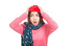 Asian girl with red christmas hat shock put her hands on her hea Royalty Free Stock Photos