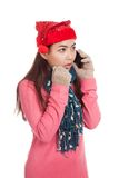 Asian girl with red christmas hat shock talk on mobile phone Royalty Free Stock Photos