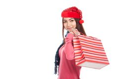 Asian girl with red christmas hat with shopping bag Stock Photos