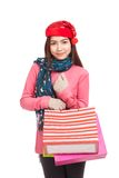 Asian girl with red christmas hat with shopping bags Stock Photo