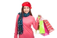 Asian girl with red christmas hat with shopping bags Royalty Free Stock Image
