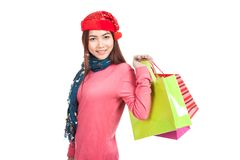 Asian girl with red christmas hat with shopping bags Royalty Free Stock Photography