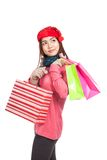 Asian girl with red christmas hat with shopping bags Stock Photography