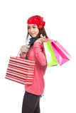 Asian girl with red christmas hat with shopping bags Stock Photos