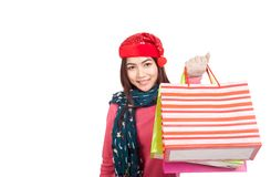 Asian girl with red christmas hat with shopping bags Stock Images
