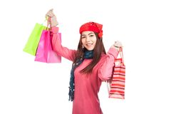 Asian girl with red christmas hat with shopping bags Royalty Free Stock Images