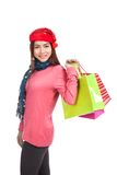 Asian girl with red christmas hat with shopping bags Stock Image