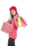 Asian girl with red christmas hat with shopping bags Royalty Free Stock Photos