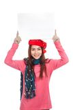 Asian girl with red christmas hat show blank sign overhead Royalty Free Stock Photo
