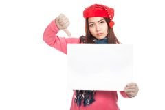 Asian girl with red christmas hat show blank sign and thumbs dow Royalty Free Stock Photos