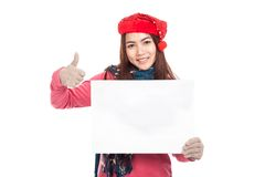 Asian girl with red christmas hat show blank sign and thumbs up Royalty Free Stock Image