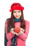 Asian girl with red christmas hat show a gift box Royalty Free Stock Photos