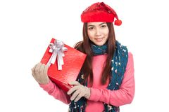 Asian girl with red christmas hat show a gift box Royalty Free Stock Images