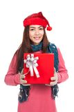 Asian girl with red christmas hat show a gift box Stock Image