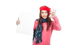 Asian girl with red christmas hat show OK sign and blank sign ve Royalty Free Stock Photos