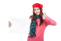 Asian girl with red christmas hat show thumbs up and  blank sign Royalty Free Stock Photos