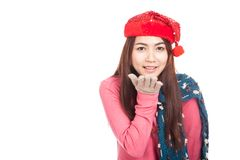 Asian girl with red christmas hat smile blowing a kiss Royalty Free Stock Images