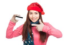 Asian girl with red christmas hat smile point to  credit card Royalty Free Stock Photography